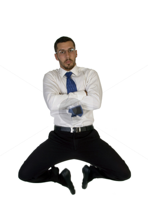 Businessman leaps in air stock photo, Businessman leaps in air on an isolated background by Imagery Majestic