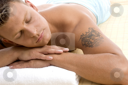 Handsome male lying in spa resort stock photo, Handsome male lying in spa resort against white background by Imagery Majestic