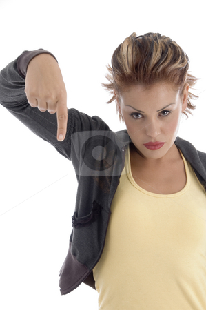 Young female pointing down stock photo, Young female pointing down on an isolated background by Imagery Majestic
