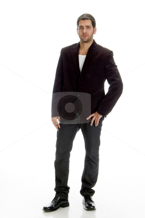 Standing young handsome man stock photo, Standing young handsome man against white background by Imagery Majestic