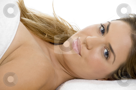 Laying sexy caucasian lady stock photo, Laying sexy caucasian lady against white background by Imagery Majestic