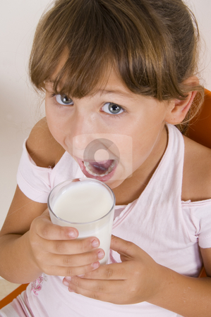 Girl going to drink milk stock photo, Girl going to drink milk by Imagery Majestic