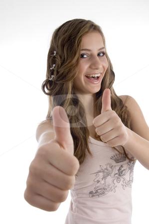 Young girl wishing good luck stock photo, Young girl wishing good luck against white background by Imagery Majestic