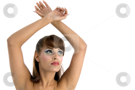 Female with raised arms stock photo, Female with raised arms on an isolated background by Imagery Majestic