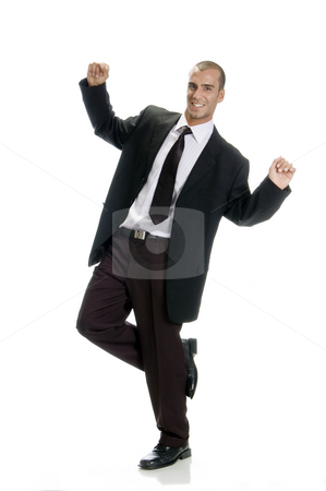 Happy successful man stock photo, Happy successful man standing on one leg by Imagery Majestic
