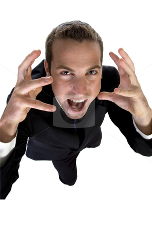 Young businessman shouting and looking upside stock photo, Young businessman shouting and looking upside with white background by Imagery Majestic