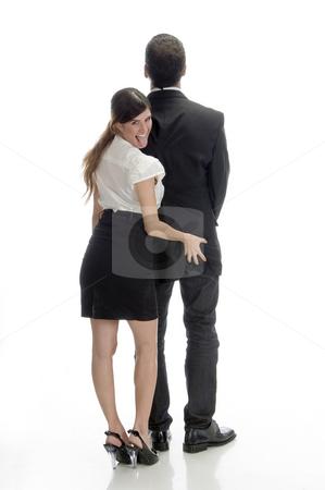 Sexy woman pushing man's back stock photo, Sexy woman pushing man's back isolated on white background by Imagery Majestic