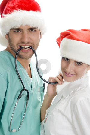 Posing medical professionals with stethoscope stock photo, Posing medicals professional with stethoscope on an isolated background by Imagery Majestic