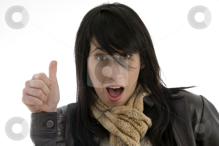Woman giving shocking expression with thumbs up stock photo, Woman giving shocking expression with thumbs up isolated on white background by Imagery Majestic