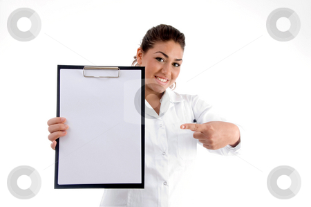 Smiling doctor indicating the writing board stock photo, Smiling doctor indicating the writing board against white background by Imagery Majestic