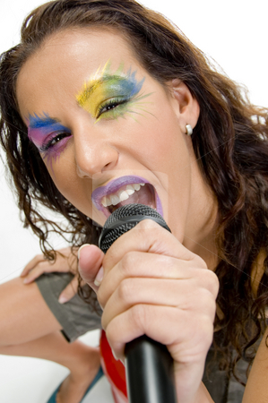 Woman singing into microphone stock photo, Close up of woman singing into microphone by Imagery Majestic