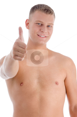 Smiling muscular man showing approval sign stock photo, Smiling muscular man showing approval sign on an isolated background by Imagery Majestic