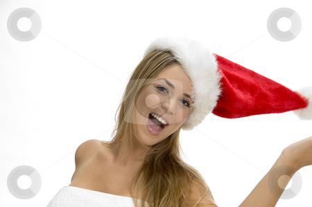 Posing smiling model with santa cap stock photo, Posing smiling model with santa cap by Imagery Majestic