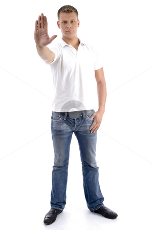 Male gesturing stop with his hand stock photo, Male gesturing stop with his hand isolated on white background by Imagery Majestic