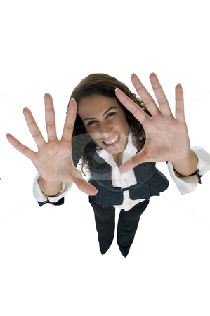 Woman cheering with palms stock photo, Woman cheering with palms against white background by Imagery Majestic