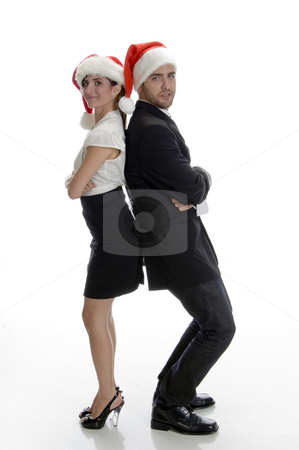 Smiling couple posing with santa cap stock photo, Smiling couple posing with santa cap on an isolated white background by Imagery Majestic