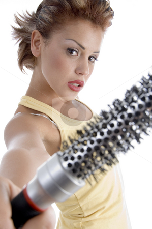 Woman posing with roller comb stock photo, Woman posing with roller comb on an isolated background by Imagery Majestic
