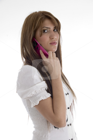 Woman talking on cell phone stock photo, Woman talking on cell phone against white background by Imagery Majestic