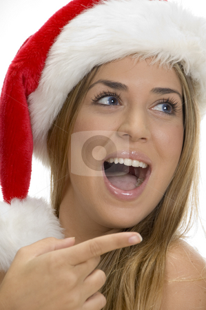 Pointing sexy female with santa cap stock photo, Pointing sexy female with santa cap by Imagery Majestic