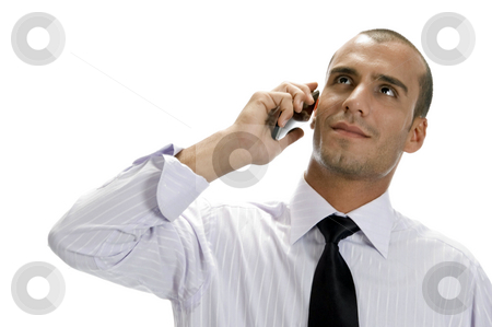 Businessman talking on mobile phone stock photo, Businessman talking on mobile phone with white background by Imagery Majestic