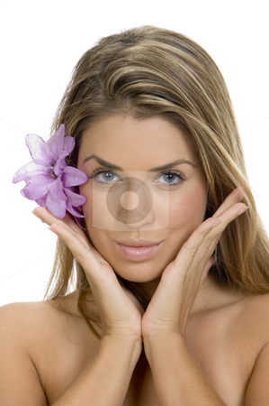 Posing woman with flower in her hair stock photo, Posing woman with flower in her hair by Imagery Majestic