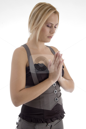 Praying young woman stock photo, Praying young woman with white background by Imagery Majestic