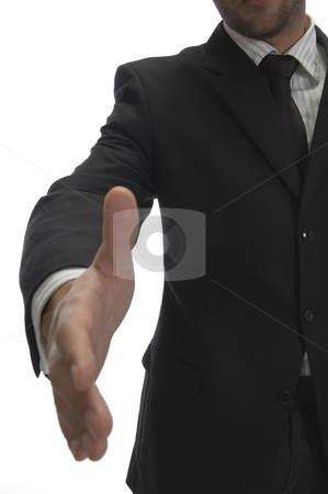 Businessman offering handshake stock photo, Businessman offering handshake on an isolated background by Imagery Majestic