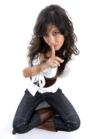 Beautiful female shushing stock photo, Beautiful female shushing on an isolated white background by Imagery Majestic