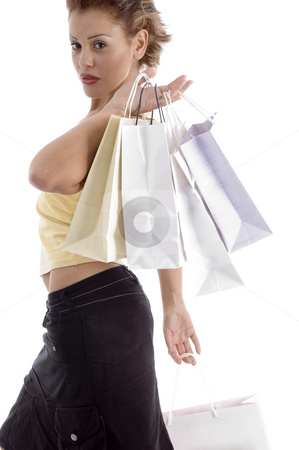 Sexy young woman with shopping bag stock photo, Sexy young woman with shopping bag against white background by Imagery Majestic