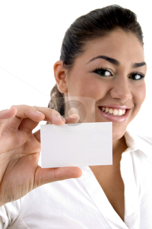 Young female showing business card stock photo, Young female showing business card against white background by Imagery Majestic