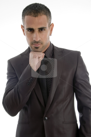 Man holding chin on his fist stock photo, Man holding chin on his fist against white background by Imagery Majestic