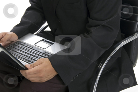 Male hands typing an a laptop close up stock photo, Male hands typing an a laptop close up with white background by Imagery Majestic
