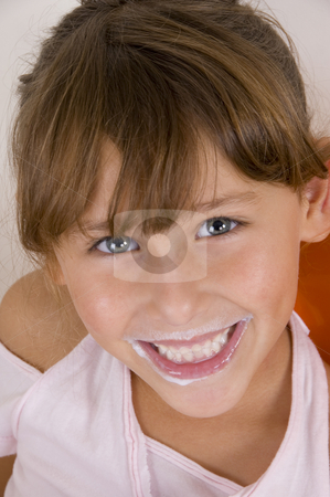 Smiling little girl looking at the camera stock photo, Smiling little girl looking at the camera by Imagery Majestic