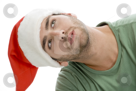 Man with santa cap and looking upward stock photo, Man with santa cap and looking upward with white background by Imagery Majestic