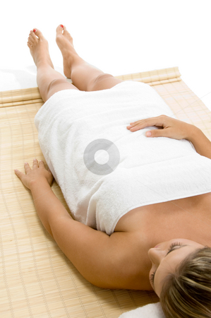 Portrait of laying blonde female stock photo, Portrait of laying blonde female on an isolated white background by Imagery Majestic