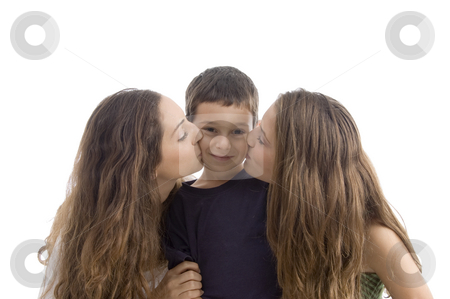 Beautiful girl kissing of young little boy stock photo, Beautiful girl kissing of young little boy with white background by Imagery Majestic