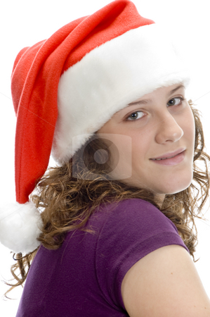 Lady posing with santa cap stock photo, Lady posing with santa cap on an isolated background by Imagery Majestic
