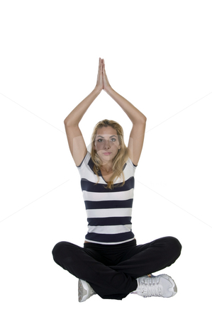 Young woman in yoga pose stock photo, Young woman in yoga pose against white background by Imagery Majestic