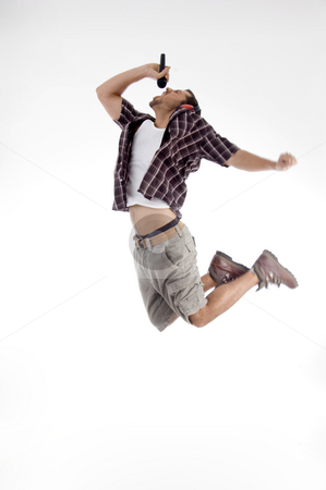 Young singer singing a song in rock style stock photo, Young singer singing a song in rock style on an isolated white background by Imagery Majestic