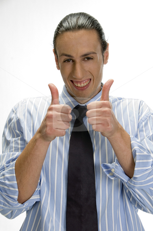 Businessman gesturing thumbs up  stock photo, Businessman gesturing thumbs up on an isolated white background by Imagery Majestic