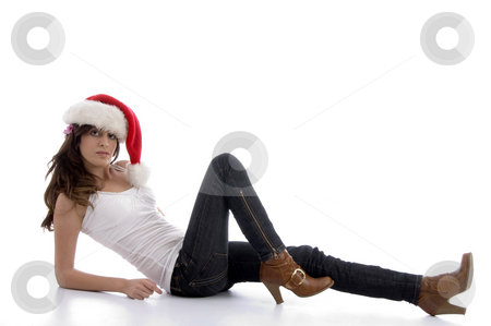 Laying glamorous woman with christmas hat stock photo, Laying glamorous woman with christmas hat on an isolated background by Imagery Majestic