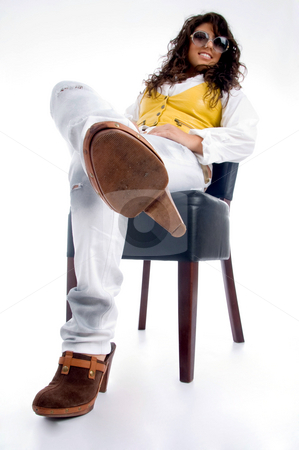 Smiling woman sitting on chair stock photo, Smiling woman sitting on chair on an isolated background by Imagery Majestic