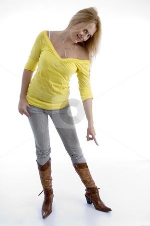 Smiling woman indicating her shoes stock photo, Smiling woman indicating her shoes with white background by Imagery Majestic