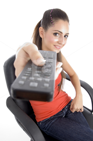 Sitting girl showing remote stock photo, Sitting girl showing remote on an isolated white background by Imagery Majestic