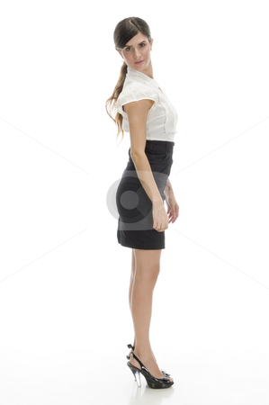 Side view of standing lady stock photo, Side view of standing lady against white background by Imagery Majestic