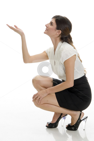 Sitting lady looking upside stock photo, Sitting lady looking upside on an isolated background by Imagery Majestic