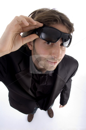 Standing man holding sunglasses stock photo, Standing man holding sunglasses on an isolated background by Imagery Majestic
