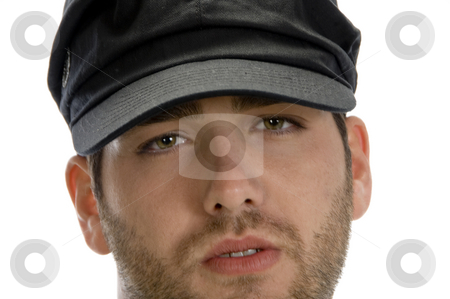 Grumpy Young Man with hat stock photo, Grumpy Young Man with hat on an isolated white background by Imagery Majestic