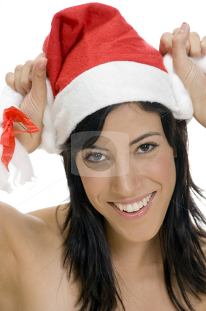 Smiling woman holding santa cap stock photo, Smiling woman holding santa cap with white background by Imagery Majestic