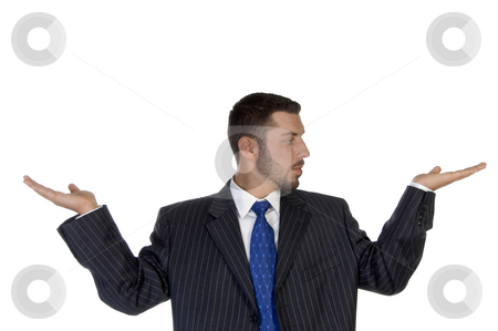 Businessperson looking his palm stock photo, Businessperson looking his palm with white background by Imagery Majestic